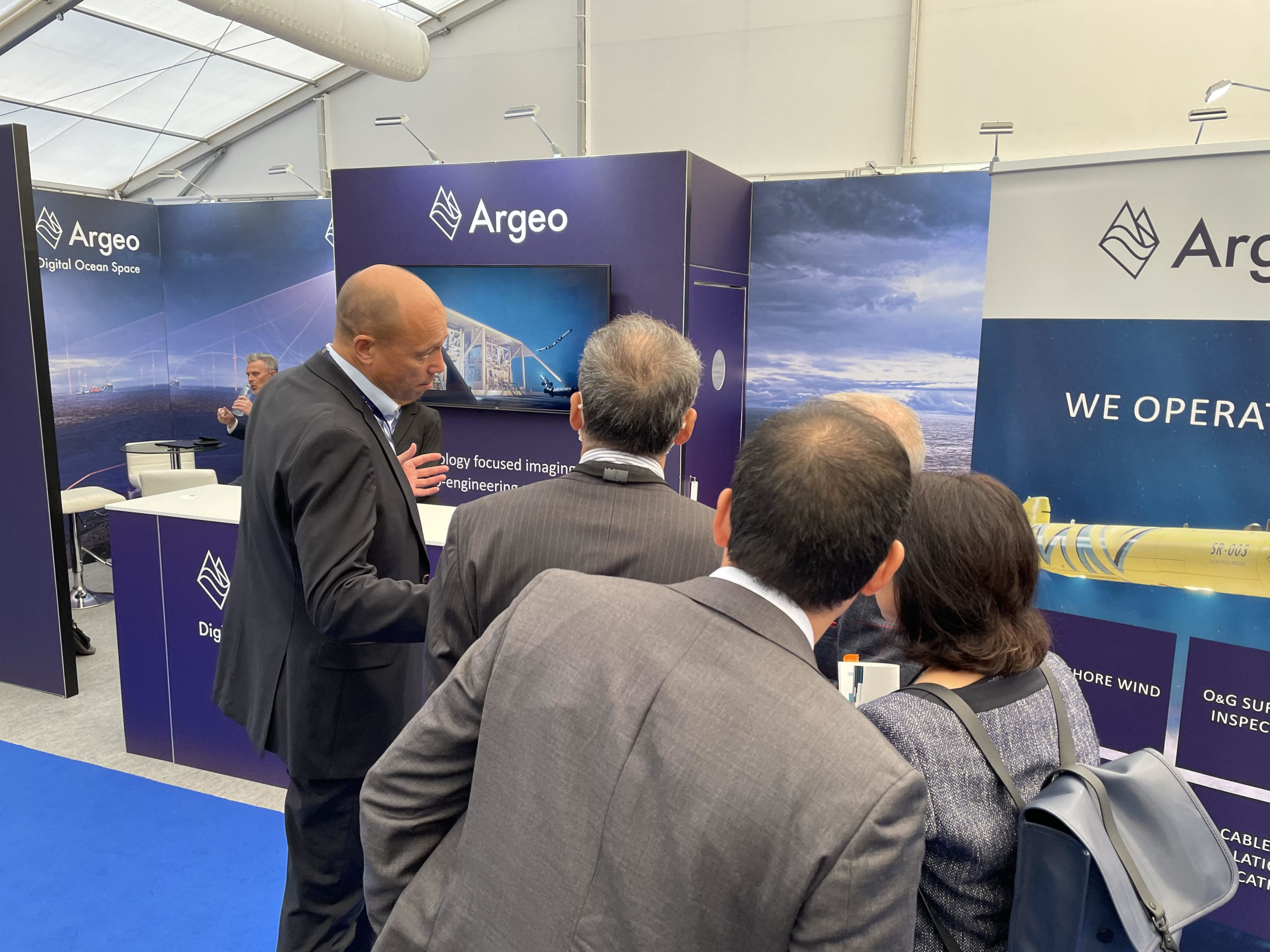 Visitors attending the Argeo booth at Ocean Business 2021 in Southampton